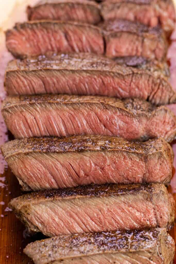 slicing the cooked steak into cubes