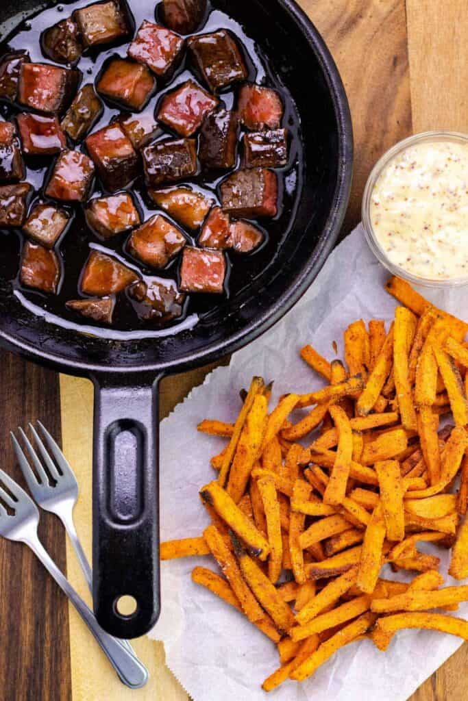 Root Beer Beef Bites with Honey Dijon Aioli and a side of sweet potato fries