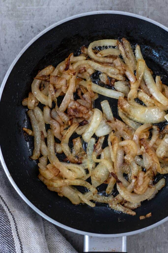 golden brown caramelized onions in a small fry pan