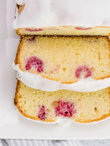 slicing servings of the raspberry lemon loaf