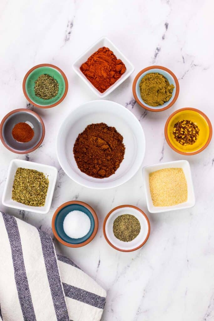 all of the ingredients needed to make homemade taco seasoning portioned into small bowls