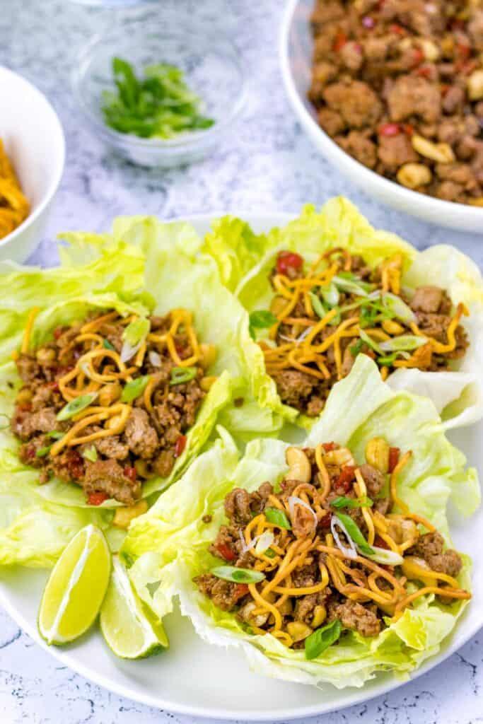 assembled turkey lettuce wraps with crispy noodles on top