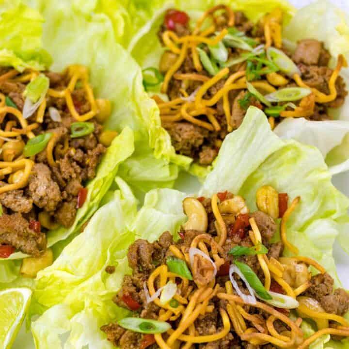 three turkey lettuce wraps on a plate