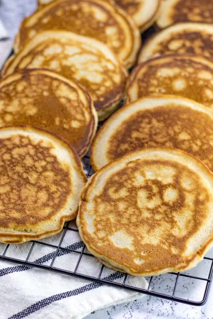 a batch of pancakes on a wire rack