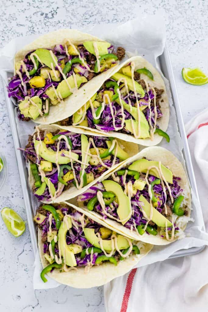 Spicy Caribbean Beef Tacos on a baking sheet