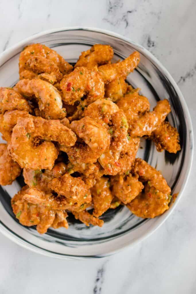 prepared bang bang shrimp on a marble serving dish