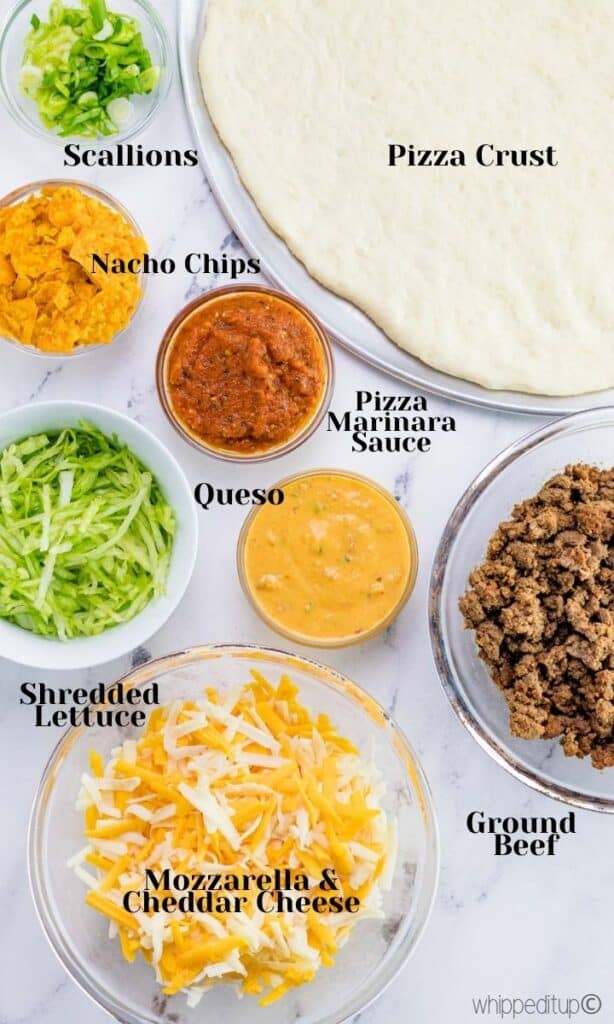 all of the ingredients required to make nacho pizza